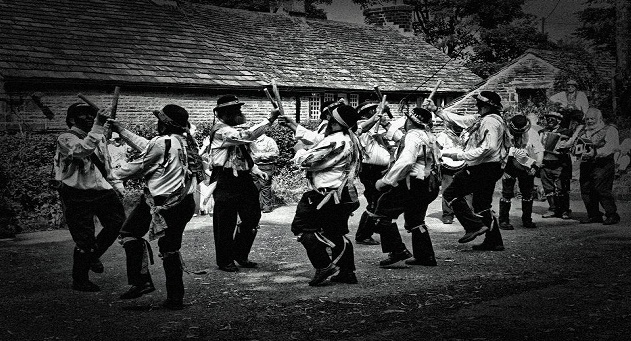 A Grayscale Image of Border Morris Men Dancing